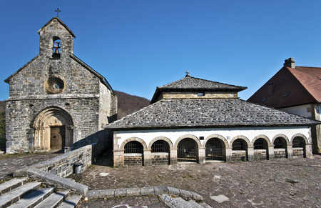 Gothic Chapel Santiago, gold los Pelegrinos, at left and Sancti Spiritus Roman Chapel, at right in Roncesvalles Village, Navarre, Basque Country, Spain