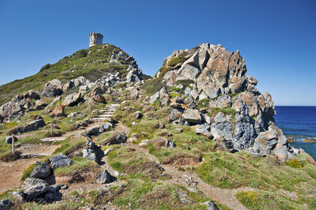genoese: Walk pass to Genoese Tower of Parata Pointe in Corsica,  Ajaccio, Corse-du-Sud, the west coast of the French island of Corsica Stock Photo