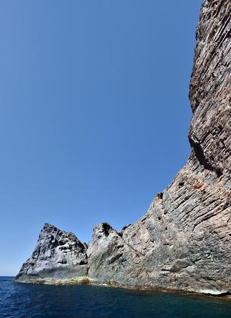columnar: Vertical Basaltic columnar formations of Scandola peninsula rocks , Scandola Nature reserve, Corse-du-Sud, France