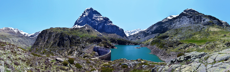 gloriette: Gloriette reservoir and the Dam in French Pyrenees, Mountains of Troumouse Circus is at left, ridge of Chourrugue and  Estaube Circus is in center background and Pimene Peak at right, Hautes Pyrenees, France