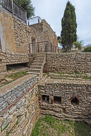 Genoese house ruins in Old City of Bonifacio, this medieval foundation and walls are named The Vestige Garden, Corsica Island, France Stock Photo