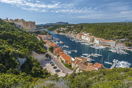 Landscape of Bonifacio with the Harbor and The Citadel at left. Corsica Island, France 写真素材