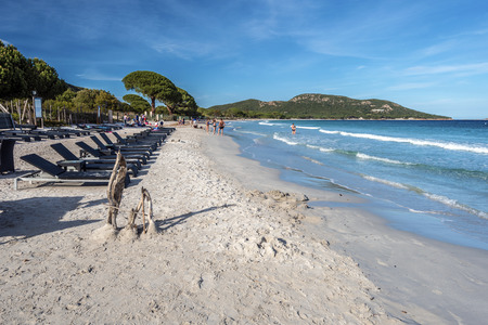 Palombaggia, France - April 17, 2016 Palombaggia beach in southern Corsica white sand and turquoise water of Mediterranean Sea is at foreground, South Corsica, France