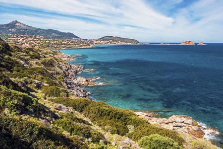 Coastline landscape in approach Ile-Rousse city in Corsica Island, seen at background with Pietra islet at right, Haute-Corse, France 写真素材