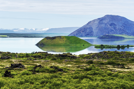 Landscape of Myvatn Lake in Northern Iceland. Islet of volcanic pseudo crater is a middle.
