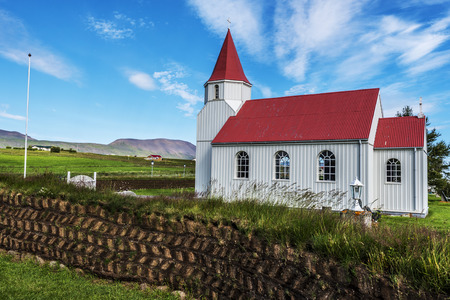 Wooden church in Glaumbaer Farm in Northern Iceland. The wall made with turf blocks is at foreground. Reklamní fotografie