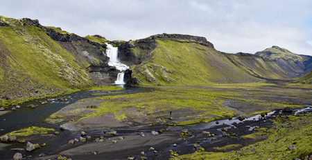 Panoramic view of Eldgja Canyon with the flow of Nordari-Ofaera river and Ofaerufoss waterfall in southern highlands of Iceland. The west of Vatnajokull National park.