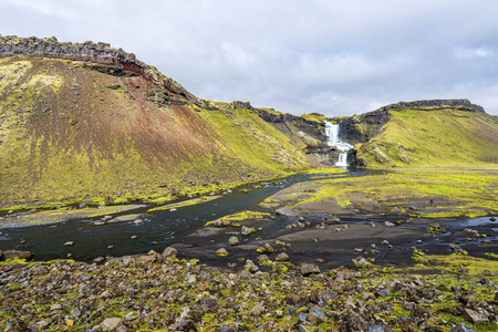 Landscape of Eldgja Canyon with the flow of Nordari-Ofaera river and Ofaerufoss waterfall in southern highlands of Iceland. The west of Vatnajokull National park.