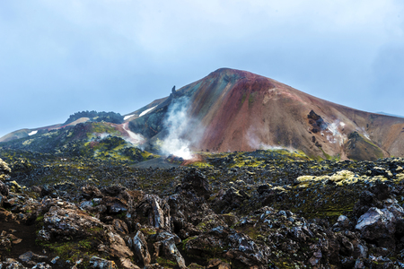 Brennisteinsalda Volcano mountain and its active fumaroles and solfataras in Landmannalaugar seen from the lava field at summer midnight. Iceland Highlands, Fridland ad Fjallabaki Natural park