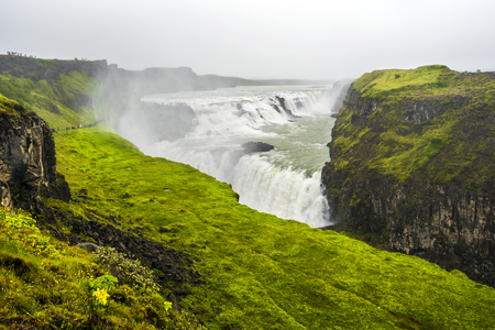 Gullfoss waterfall in the fog. Canyon of Hvita river in southwestern Iceland.