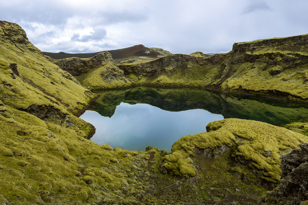 Tjarnargigur Crater filled with water is one of the most impressive craters of Lakagigar volcanic fissure area in Southern Highlands of Iceland. Pond Crater.