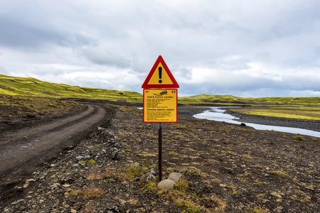 The guarantee sign in the Lakagigavegur F207 road with advices how to cross fords. It's the way to visit Lakagigar volcanic fissure area in Southern Highlands of Iceland. 写真素材 - 125486670