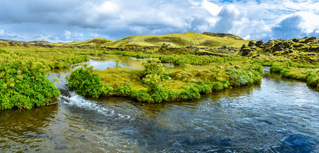 Panoramic view of the water flow when following the Lakagigavegur road F207 in the way to Lakagigar volcanic fissure area in Southern Highlands of Iceland. Ulfarsdalur valley. 写真素材 - 125486672