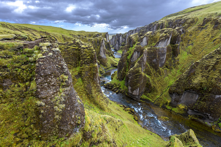 View of Fjadrargljufur Canyon towards the Atrantic Ocean, via the downstream of Fjadra river. South East of Iceland. 写真素材 - 125486673