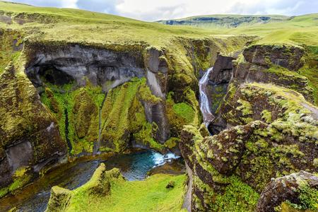 View of Fjadrargljufur Canyon towards the waterfall, and upstream of Fjadra river. South East of Iceland.