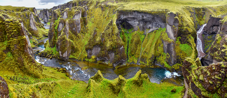 Panoramic View of Fjadrargljufur Canyon from the waterfall at the Fjadra river via the Atrantic Ocean at left. South East of Iceland. 写真素材