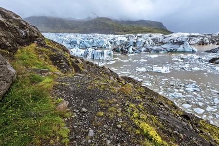 Breidamerkurjokull glacier and Jokulsarlon Lagoon viewed from hiking pass in southeastern Iceland. Vatnajokull national park. 写真素材 - 125486677