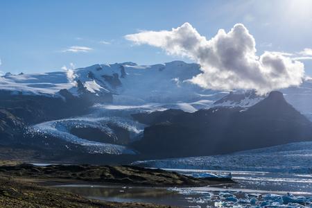 Oraefajokull massive landscape, viewed from the border of Fjallsarlon glacier lake facing to the sun in Southern Iceland. Vatnajokull National Park.