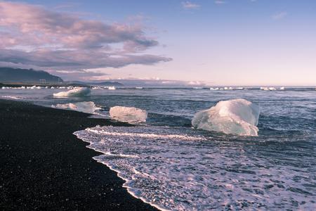 Small icebergs drifting from, Jokulsarlon Glacier Lagoon to Atlantic Ocean in Southeastern Iceland.