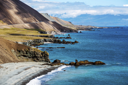 The coastline in Eastern Iceland as seen from Illiskuti point towards Fauskasandur beach and Styrmisnes point. The slope of Maelifell hill is at left. 写真素材 - 125486211