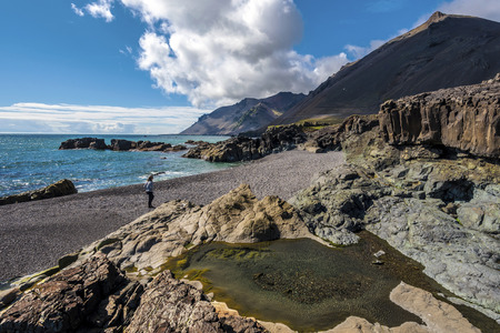 View at Fauskasandur beach in the Eastern Iceland. Maelifell hill is at right background.