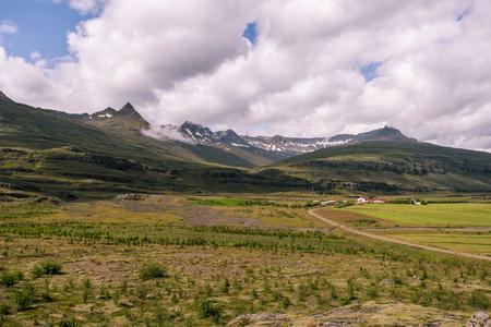 Bragdavellir farm area in Djupavogshreppur municipality of Eastern Iceland. Snaedalur valley and peaks Midaftanstindur at right and Djupavogshreppur at left background.