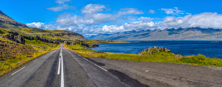 Ring road 1 in Eastern Iceland at Stodvar Fjord at right. 写真素材
