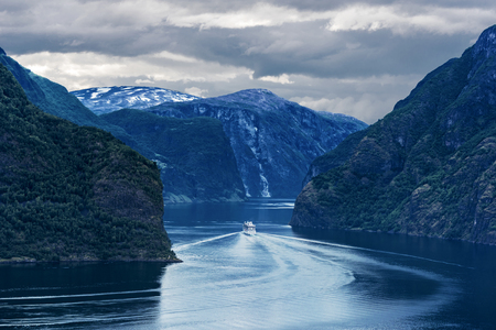 View of Aurlandsfjord from Stegastein viewpoint in Sogn og Fjordane county of Norwey. Cruise ship is moving via Sognefjorden, Norway's longest fjord.