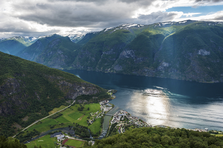 Panoramic view of Aurlandsfjord from Stegastein viewpoint in Sogn og Fjordane county of Norwey. Aurlandsvangen town and the river Aurlandselvi river joying the fjord are at left. 写真素材 - 125486074