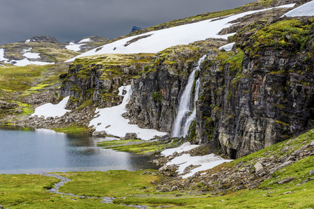 Flotvatnet lake and the waterfall in Aurlandsfjellet mountainous area in Sogn og Fjordane county of Norway