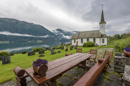 Nes church in the border of Lustrafjorden. Hoyheimsvik, Norway.