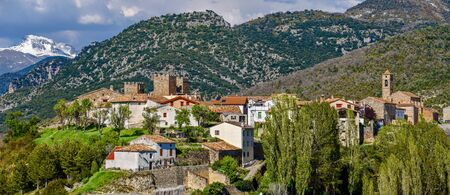 Panoramic view of Binies village in Aragon region of Spanish Pyrenees. The castle and at left San Salvador church is at right.