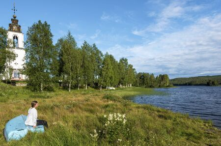 Storan-Osterdalalven lake, Protestant church of Idre village is at right background. Dalarna county in Sweden. 写真素材