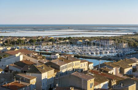 Marina of Gruissan town, the Pond ant Mediterranean coastline as seen from Barberousse Tower. Occitanie, France. 写真素材