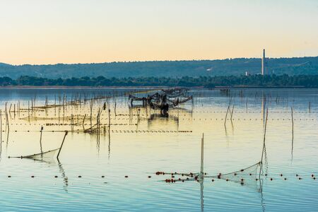 Oyster and fishing farming area of Ayrolle Pond in Narbonaise Mediterranean National Park.  Occitanie, France