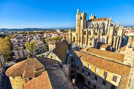 Cathedral of St. Just and Saint Pasteur and Narbonne historical city center as seen from the tower of the city hall. Occitanie, France