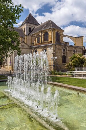 Cathedral Notre Dame in Dax town, as seen from the park, the fountain is at foreground. Southwestern France, Landes, Nouvelle Aquitaine.