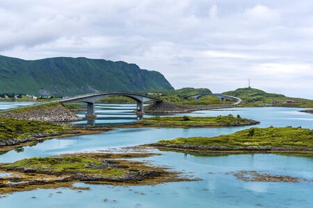 The bridge Fredvangbruene in Lofotene archipelago connecting main touristic road E10 with Torvoya Island and further Fredvang community in Flakstad. Nordland, Northern Norway.