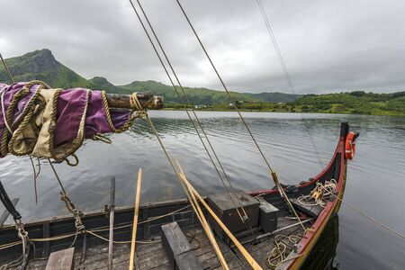 Parts of reconstructed Viking ships in the border of Innerpollen salty lake in Vestvagoy island of Lofoten archipelago. 写真素材