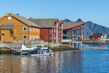 Svolvaer, Norway - August 3, 2017  Hotel buildings in the islet of Lamholmen in the center of Svolvaer Town. Hydroplane and Waters of Vestfjord are at foreground. Lofoten archipelago, Nordland, Northe