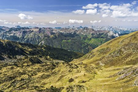 View of Aspe Valley from Ayous mountain pass as seen in October. Mountain Chains of Atlantic Pyrenees are at background. Aquitaine, France.