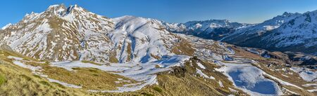 Panoramic view of upper Tena Valley in Spanish Pyrenees from eastern slopes close to Portalet mountain pass. Aragon, Huesca.