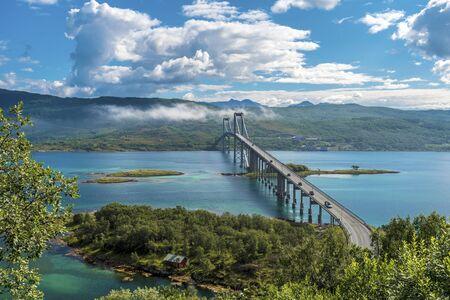 The Tjeldsund Bridge through Tjeldsundet strait viewed from Hinnoya Island, the mainland of Norwegian Troms county is at background.