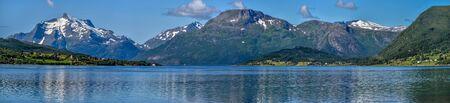 Panoramic view of Tjeldsundet strait from Harvik locality of Hinnoya island coastline via Tjeldoya Island. Nordland, Norway. 版權商用圖片