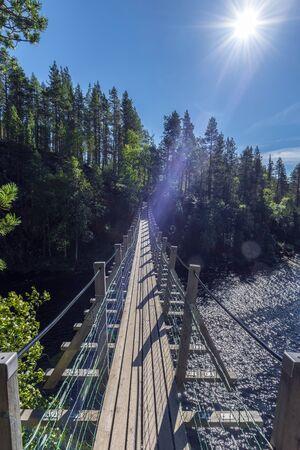 Facing to the sun, Jyravanjarvi and Ala-Juumajarvi lakes in Oulanka National Park in Finland. Pieni Karhunkierros Trail.