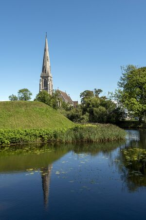 Copenhagen, Denmark-August 23, 2017 Saint Alban? ?? s Church as seen from the pond surrounding Kastellet Fortress.