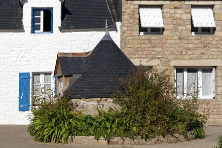Facade parts of Typical constructions in Breton village of Houat island in French Brittany