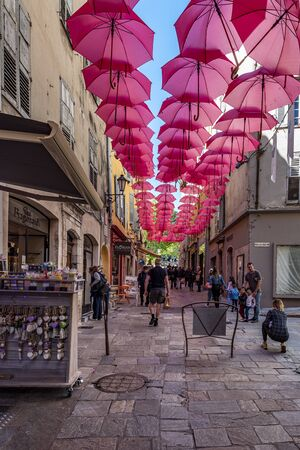 Grasse, France-April 24, 2019 Jean Ossola Street in center of Grasse town. Shops and boutiques walk area in the world capital of perfumery.