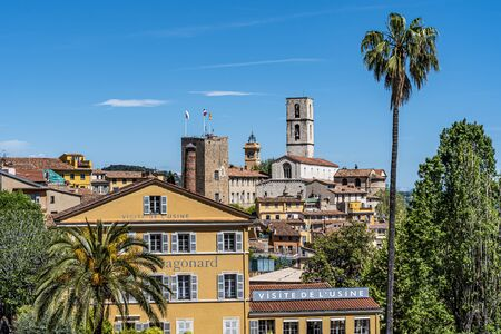 Grasse, France-April 24, 2019 Cityscape of Grass city with famous Fragonard perfume factory at foreground and the cathedral Notre Dame de Puy De Grasse at background.