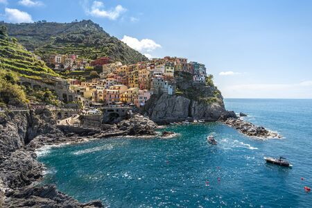 Manarola village viewed from the harbor facing to the sunlight. Cinque Terre National parc  in the Northwest of Italy.